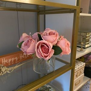 Faux pink mauve roses in glass vase